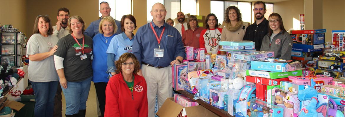 Calloway County district administrators and school administrators assisted with the Santa project by unloading donations and helping to organize the toys.