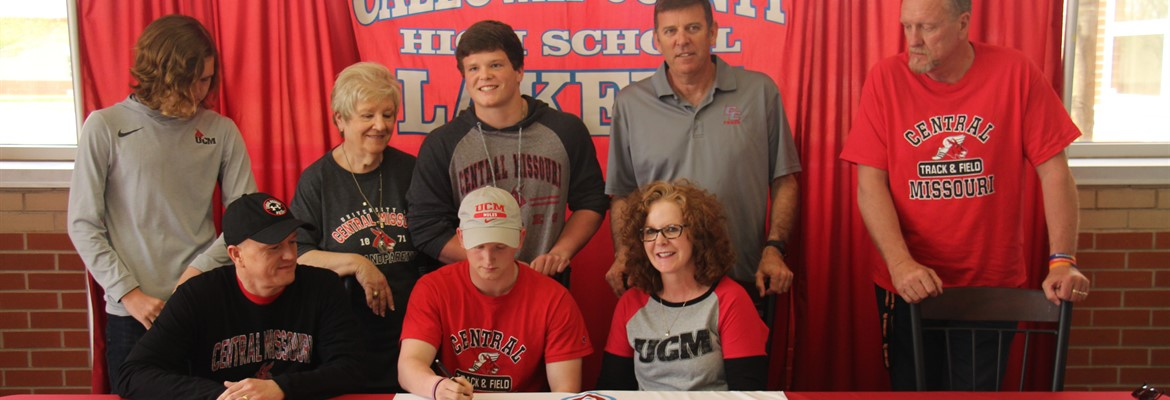 Christian Bobo signing his letter of intent to run track for Central Missouri University.