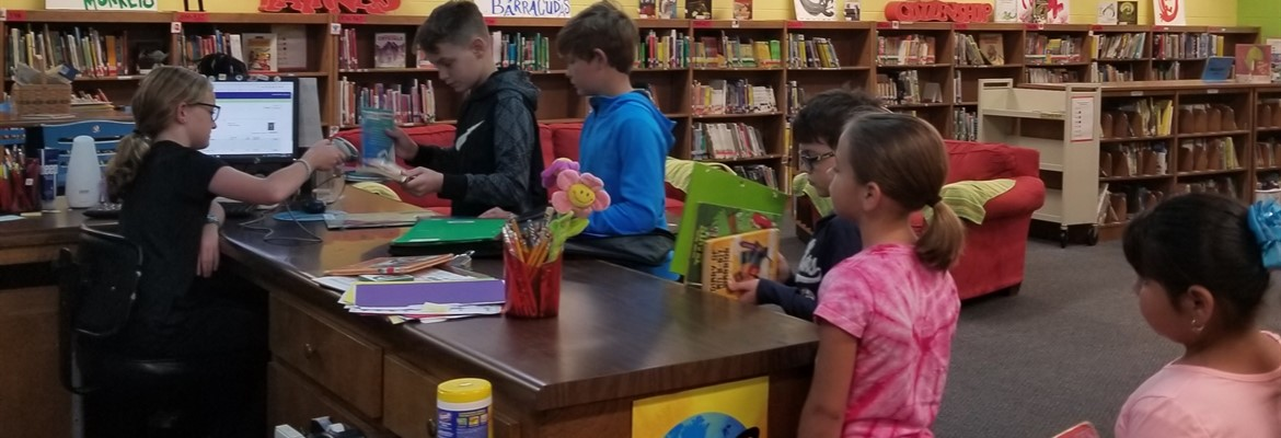 Checking out more books at North Elementary.