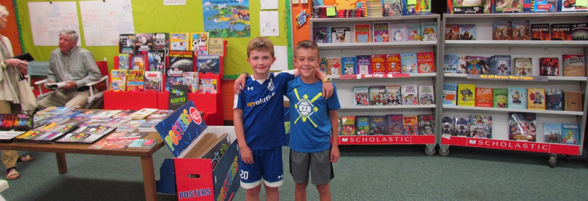 Reading buddies visit the bookfair.