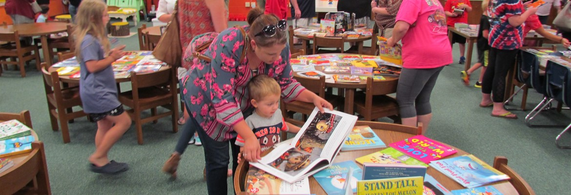 Families read books at the Bookfair.