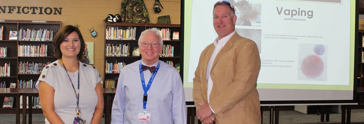 Mrs. Turner, posed with Dr. Patrick Withrow, and Mr. Settle after Dr. Withrow's presentation on the dangers of vaping and addiction with seventh and eighth grade students.  Dr. Withrow is Director of Outreach for Baptish Health Paducah.