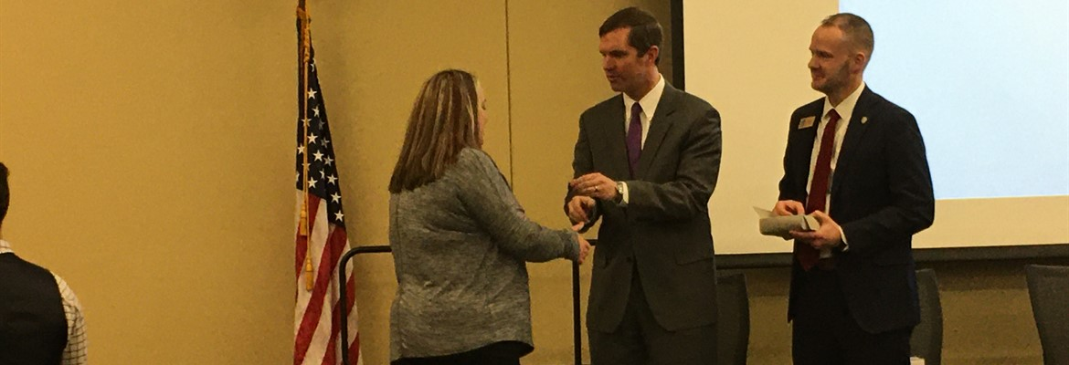 Ms. Teresa Gore, teacher at CCPS, receiving her National Board Certification pin by Governor Andy Beshear in Frankfort.