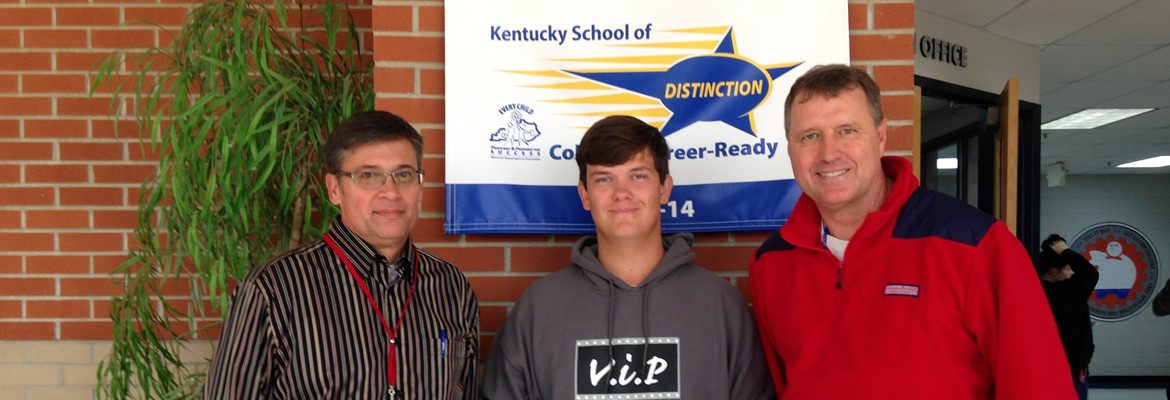 CCHS students with High Attendance were recently rewarded with coupons for local businesses.  Pictured are F. Ashby-DPP, Gideon Miller-Senior Award Winner, and R. McCallon-Principal.
