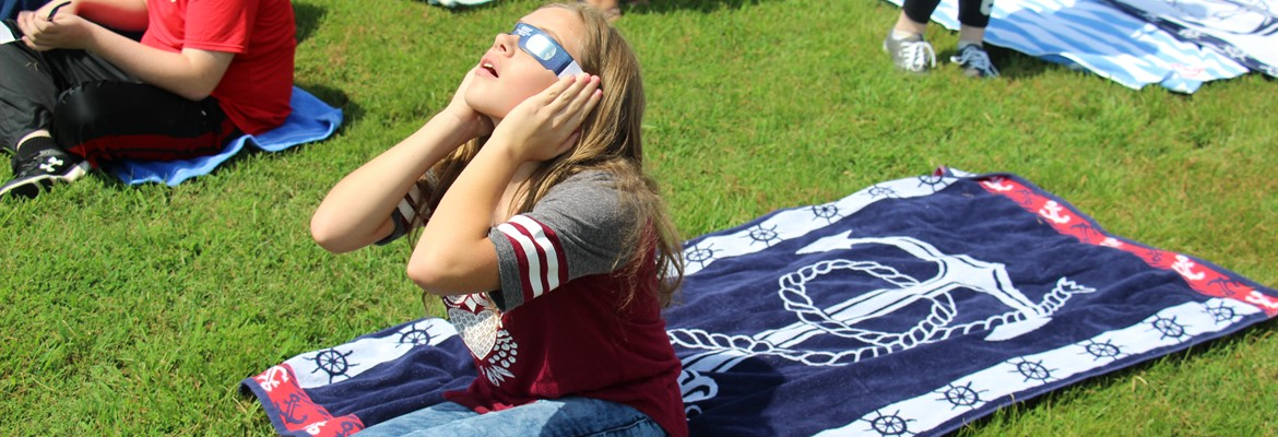 CCMS student was prepared with her own Laker towel for the eclipse viewing.