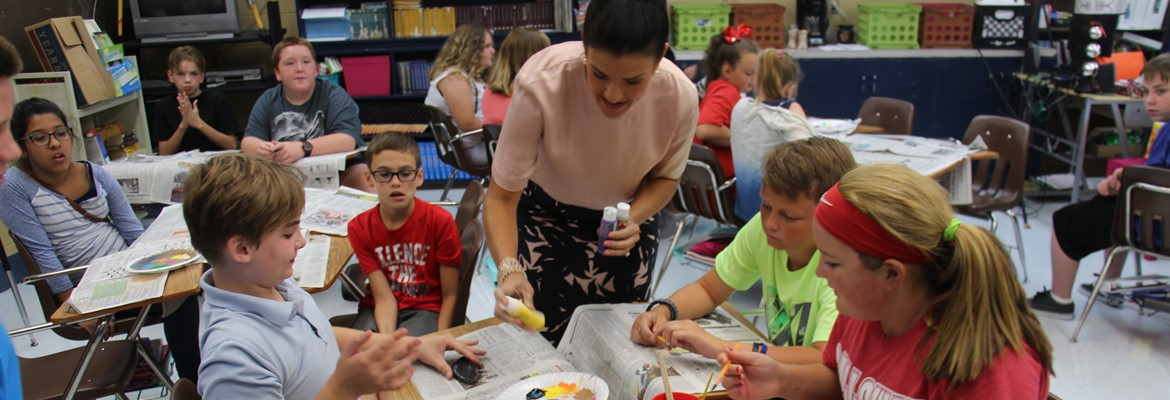 Mrs.Underhill's 6th grade class painted rocks today about something in their lives that made them happy.